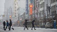 Police believe a video that shows a man kicking presumably homeless men in the groin was shot in Vancouver's Granville Street entertainment district. (Jonathan Hayward/The Canadian Press)
