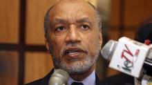 """FILE - In this May 10, 2011 file picture Mohamed bin Hammam, chief of the Asian Football Confederation, talks to local media in Port of Spain, Trinidad & Tobago. Former FIFA presidential candidate Mohamed bin Hammam resigned from all football-related positions and was banned for life by world football's governing body following """"repeated violations"""" of its code of ethics while head of the Asian Football Confederation, it has been reported Monday, Dec. 17, 2012. (Shirley Bahadur/AP)"""
