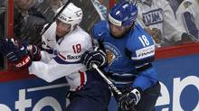 France's Yohann Auvitu (R) chases Finland's Jesse Joensuu during their 2012 IIHF men's ice hockey World Championship game in Helsinki May 10, 2012. (GRIGORY DUKOR/REUTERS/GRIGORY DUKOR/REUTERS)