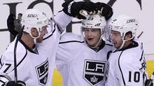 Los Angeles Kings right wing Dustin Brown (23) celebrates his goal against the Vancouver Canucks with teammates Jeff Carter (77) and Mike Richards (10) during third period NHL Stanley Cup playoff hockey action at Rogers Arena in Vancouver, B.C. Wednesday. (JONATHAN HAYWARD/The