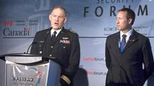 Defence Minister Peter MacKay, right, looks on as General Walter Natynczyk, chief of the defence staff, answers a question at the Halifax International Security Forum in Halifax on Sunday Nov. 22, 2009. (Andrew Vaughan/Andrew Vaughan/The Canadian Press)