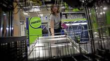 A customer opens up a dishwasher on display at a Lowe's store in Atlanta in this file photo. (David Goldman/AP)
