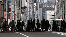 Tokyo's Ginza shopping district. Calculations by High Frequency Economics show quarterly employment in Japan has declined 5 per cent since 1998. (Toru Hanai/REUTERS)
