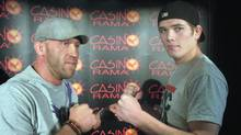 """American welterweight Josh (The People's Warrior) Burkman (left) and Jordan (Young Guns) Mein of Lethbridge, Alta., strike a pose during a news conference for """" MMA:The Reckoning,"""" in Toronto, Thursday, March 31, 2011. Organizers confirmed that Saturday's show at Casino Rama north of Toronto will be seen by some 5,000. (Neil Davidson)"""