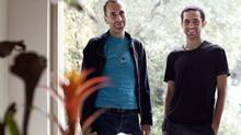 Dr. Tarek Loubani, right, and John Greyson are photographed at Mr. Greyson's home in Toronto on Oct. 13, 2013. Mr. Greyson and Dr. Loubani were arrested in Egypt in August and imprisoned for several weeks. (Moe Doiron/The Globe and Mail)