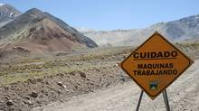 A traffic sign is seen near Barrick Gold Corp.'s Veladero gold mine in Argentina. Argentine government economic policies and capital restrictions are prompting Canadian mining firms to rethink projects in the Andean country. (Pav Jordan/Reuters/Pav Jordan/Reuters)