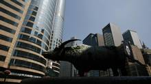 A statue of a bull stands outside Exchange Square, where the trading hall of the Hong Kong Stock Exchange is located. Hong Kong's securities regulator is seeking accounting records for a China-based client of Ernst & Young. (BOBBY YIP/REUTERS)