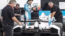 James Hinchcliffe and his team prepare for the Indy Toronto on Thursday, July 18. The Canadian has been plagued this season with collisions, mechanical failures and other problems. (Chris Young/THE CANADIAN PRESS)