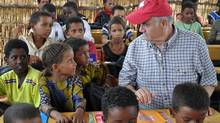 Julian Fantino visits a school in Burkina Faso run by CARE with CIDA support.