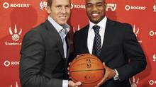 Point guard Jarrett Jack poses with Toronto GM Bryan Colangelo after signing with the Raptors in Toronto, July 21, 2009. (MARK BLINCH)