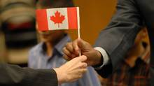 New citizens receive Canadian flags after a citizenship ceremony. (Fernando Morales)