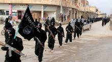 This image posted on a militant website on Tuesday, Jan. 14, 2014 shows fighters from the al-Qaida linked Islamic State of Iraq and the Levant (ISIL), now called the Islamic State group, marching in Raqqa, Syria. (THE CANADIAN PRESS/AP)