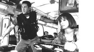 Keanu Reeves and Sandra Bullock in Speed.