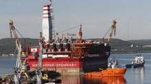 The Prirazlomnaya platform is towed from Murmansk to the Prirazlomnoye oilfield in the Pechora Sea, northern Russia, Thursday, Aug. 18, 2011. The Prirazlomnaya is the world's first offshore ice-resistant oil producing platform capable of oil production under - 50 C. (AP Photo/Andrei Pronin)