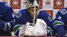 Vancouver Canucks goaltender Roberto Luongo sits on the bench after being pulled for the final minute while facing the San Jose Sharks during the third period of game 1 of the Stanley Cup playoffs in Vancouver May 1, 2013. (John Lehmann/The Globe and Mail)