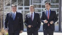 Federal Finance Minister Bill Morneau (right), Ontario Finance Minister Charles Sousa (left) and Toronto Mayor John Tory arrive for talks on the housing market in the Greater Toronto Area in Toronto on Tuesday, April 18, 2017