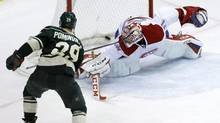 Minnesota Wild right wing Jason Pominville scores the game-winning goal past Montreal Canadiens goalie Carey Price (Ann Heisenfelt/The Associated Press)