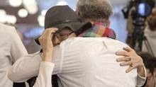Beaverhouse First Nation Chief Marcia Brown Martel, left, hugs the plaintiffs' co-lawyer Jeffrey Wilson during a news conference in Toronto on Tuesday. Ms. Martel is a plaintiff in an Ontario class-action suit against the federal government. (Chris Young/THE CANADIAN PRESS)