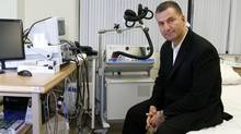 Dr. Zafiris Daskalakis, director of the new Magnetic Seizure Therapy clinic of the CAMH, photographed beside the magnetic stimulator machine that offers an alternative to traditional electroshock therapy at the clinic on Queen St., Toronto. (Fernando Morales/The Globe and Mail)