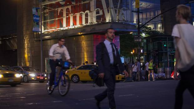 Pedestrians walk near the Time Warner Center in New York City in 2014.