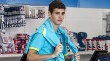 Brazilian Olympic footballer Oscar dos Santos Emboaba is seen in an Olympic store at the Athletes Village in London July 22, 2012. (Reuters)