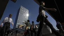 Pedestrians walk past Shinjuku Espressway Bus Terminal in Tokyo in October. Tokyo stocks are reaping double rewards from Donald Trump's win, as the weaker yen boosts the earnings outlook for the nation's exporters. (Tomohiro Ohsumi/Bloomberg)