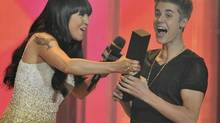 Justin Bieber accepts his award for Best International Video of the Year by a Canadian from Lauren Toyota during the MMVAs. (Mike Cassese/Reuters)