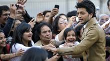 "Bollywood actor Ritesh Deshmukh greets fans at the world premiere of the film ""Double Dhamaal"" in Brampton, Ont., on Thursday, June 23, 2011. (MIKE CASSESE/Reuters)"