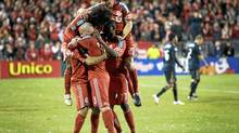 Toronto FC players celebrate the game-winning goal by Dwayne De Rosario last night at BMO Field. TFC topped Philadelphia 2-1 in their 2010 season home opener. Photo by Peter Power / The Globe and Mail (Peter Power/The Globe and Mail)