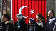 Turkish citizens line up outside the Turkish consulate to cast their votes in the Turkish referendum on March 27, 2017 in Berlin, Germany. Voting started today for Turkish citizens living abroad in the controversial referendum over whether to enlarge presidential powers in Turkey. (Sean Gallup/Getty Images)