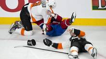 Philadelphia Flyers' Kurtis Foster charges Montreal Canadiens' Ryan White as Flyers' Kent Huskins lies on the ice after taking a hit from White during first period NHL hockey action Monday, April 15, 2013 in Montreal. (Paul Chiasson/THE CANADIAN PRESS)