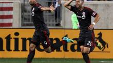 Toronto FC forward Gilberto, left, and midfielder Jonathan Osorio react after scoring a goal in the in the second half at Red Bull Arena. The game ended in a 2-2 tie. (Noah K. Murray/USA Today Sports)