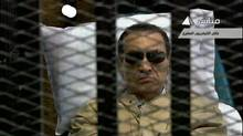 Former Egyptian president Hosni Mubarak sits inside a cage in a courtroom in Cairo in this still image taken from video on June 2, 2012. An Egyptian judge convicted Mr. Mubarak of complicity in the killings of protesters during the uprising that ended his 30-year rule and sentenced him to life in prison. (Reuters TV/Reuters TV)