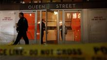 The scene outside Toronto's Queen Street station after a shooting. (John Hanley for The Globe and Mail)