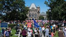 Protesters numbered in the thousands show their support at a rally for public education and democracy organized by The Elementary Teachers' Federation of Ontario at Queens Park in Toronto on Tuesday August 28, 2012. (Aaron Vincent Elkaim/THE CANADIAN PRESS)
