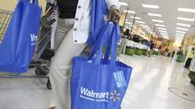 Wal-Mart Stores Inc. and other U.S. retailers are lowering the fees that shoppers pay for layaway programs ahead of the crucial Christmas shopping season. (JIM YOUNG/REUTERS)