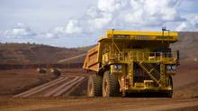 Remotely controlled tipper trucks operate at a Rio Tinto iron ore mine in Western Australia in this file undated picture made available March 26, 2012. (HANDOUT/REUTERS)