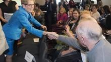 Ontario Liberal Leader Kathleen Wynne shakes hands at the closing ceremonies of Ontario Nursing Week in Toronto on May 16. (Frank Gunn/THE CANADIAN PRESS)
