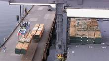 Lumber is being loaded onto Saga Viking for export to the United States from Doman Lumber in Duncan, B.C., north of Victoria. (Ian McKain/CP)