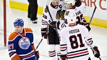 The Oilers have yet to see gains from hiring statistician Tyler Dellow in the off-season, but good teams such as the Blackhawks have had several years to integrate analytics into their organizations. (JASON FRANSON/AP)
