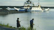 Two people fish on the Mackenzie River in this 2003 photo.New research signals a booming level of dangerous toxins in the river's fish, due to climate change. (JOHN LEHMANN/John Lehmann/Globe and Mail)