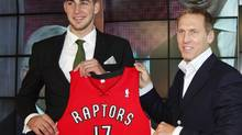 Toronto Raptors Jonas Valanciunas (L) of Lithuania and Raptors President and General Manager Bryan Colangelo holds Valanciunas' new jersey in Toronto, June 24, 2011. Valanciunas was picked in the fifth spot in the NBA's draft. (PETER JONES/REUTERS)