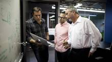 Brad Palmer, right, wants to find specialized advisers to join the board of his company, Jostle Corp., which markets a team-building, cloud-based intranet. Pictured with him are Don Wadsworth, left, vice-president of sales, and Dave Humphrey, creative director. (Rafal Gerszak For The Globe and Mail)