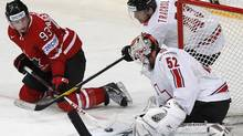 Canada's Ryan Nugent-Hopkins (L) tries to score past Switzerland's Morris Trachsler (R) and goalkeeper Tobias Stephan during their 2012 IIHF men's ice hockey World Championship game in Helsinki. (GRIGORY DUKOR/Reuters)