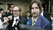 Lawyer Hersh Wolch, left, is seen with Kyle Unger outside a Winnipeg courthouse on Oct. 23, 2009. (JOHN WOODS/THE CANADIAN PRESS)