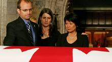 Mike Layton, his sister Sarah and Toronto MP Olivia Chow pay their respects as NDP leader Jack Layton casket lies in state in the foyer of the House of Commons on Aug. 24, 2011. (Dave Chan/Dave Chan for The Globe and Mail)