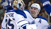 Toronto Maple Leafs goaltender Jean-Sebastien Giguere (left) is congratulated on his shutout performance by defenceman Francois Beachemin after defeating the Ottawa Senators 5-0 in NHL hockey action in Toronto on Saturday February 6, 2010.THE CANADIAN PRESS/Frank Gunn (Frank Gunn)
