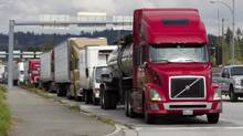 Commercial trucks pass through into the U.S.A from Canada at the Pacific Truck Crossing in Surrey, British Columbia on Oct. 3, 2013. (Ben Nelms/The Globe and Mail)
