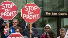 People protest outside of the B.C. Supreme Court on Sept. 6, 2016, before the start of a new lawsuit demanding private health care in Canada. (John Lehmann/The Globe and Mail)
