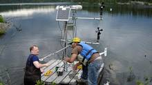 Scientists set up a micro-meterological station on a raft in this undated photo from the Experimental Lakes Area research station in Northwestern Ontario. (Handout/The Canadian Press)